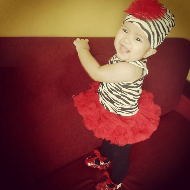 In safari inspired ballerina tutu during her Baptismal Reception (a gift from her Ninang Stef)