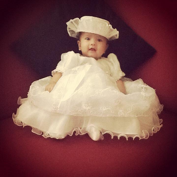Looking classy on her Baptismal dress (thanks to grandma Merlie)