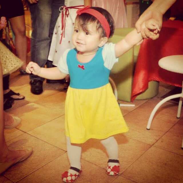 During her 1st birthday , in Snow White Onesie Dress from Mamaway