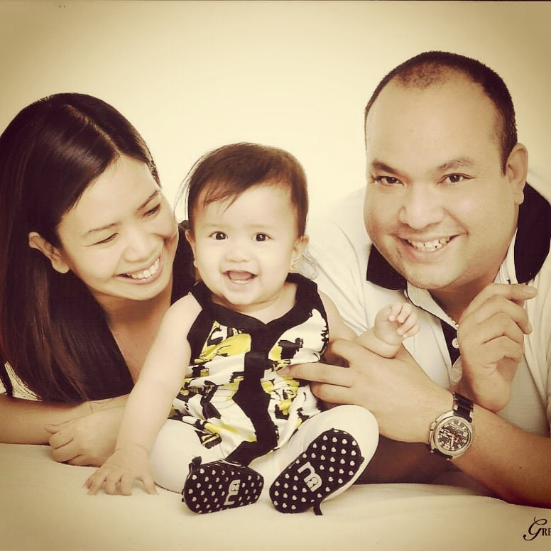 with Mommy and Daddy on her 8th month, wearing Twilo Mom&Me dress